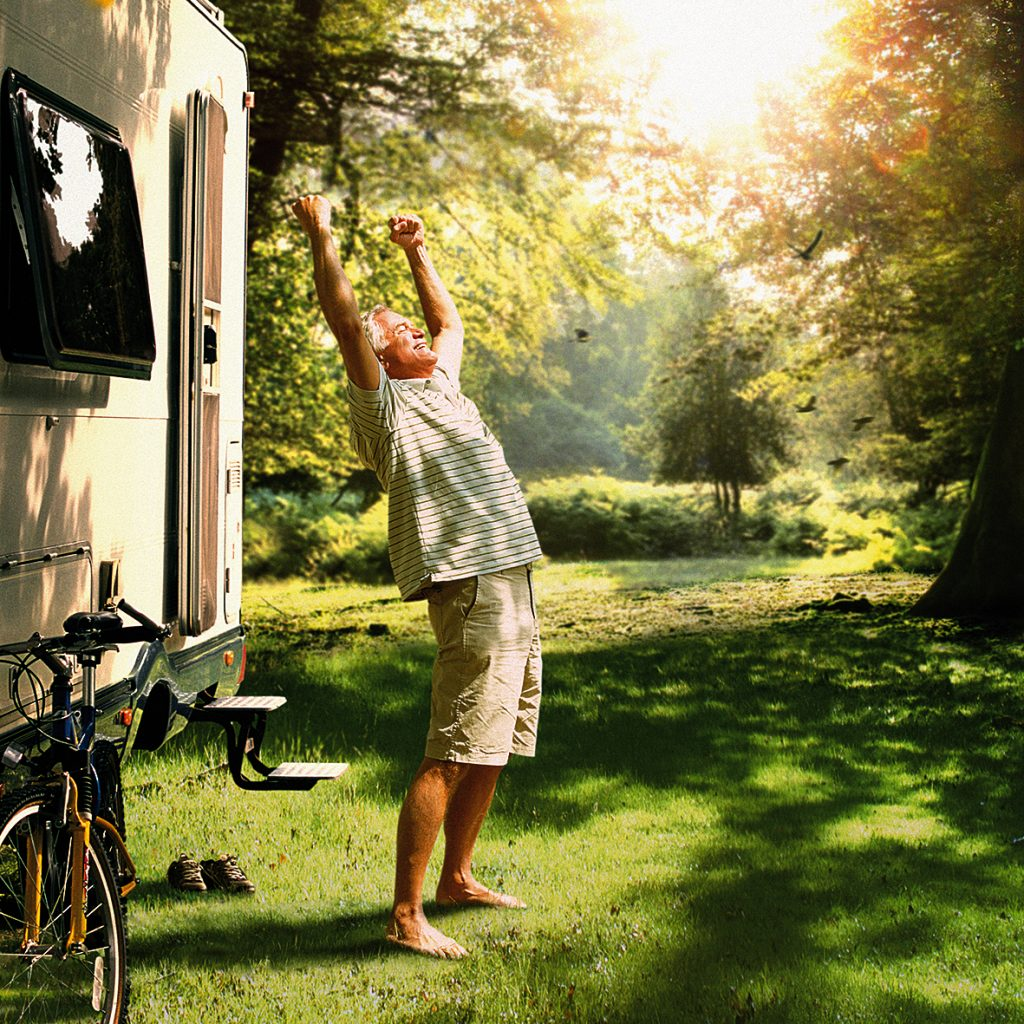 Man stretching outside his campervan