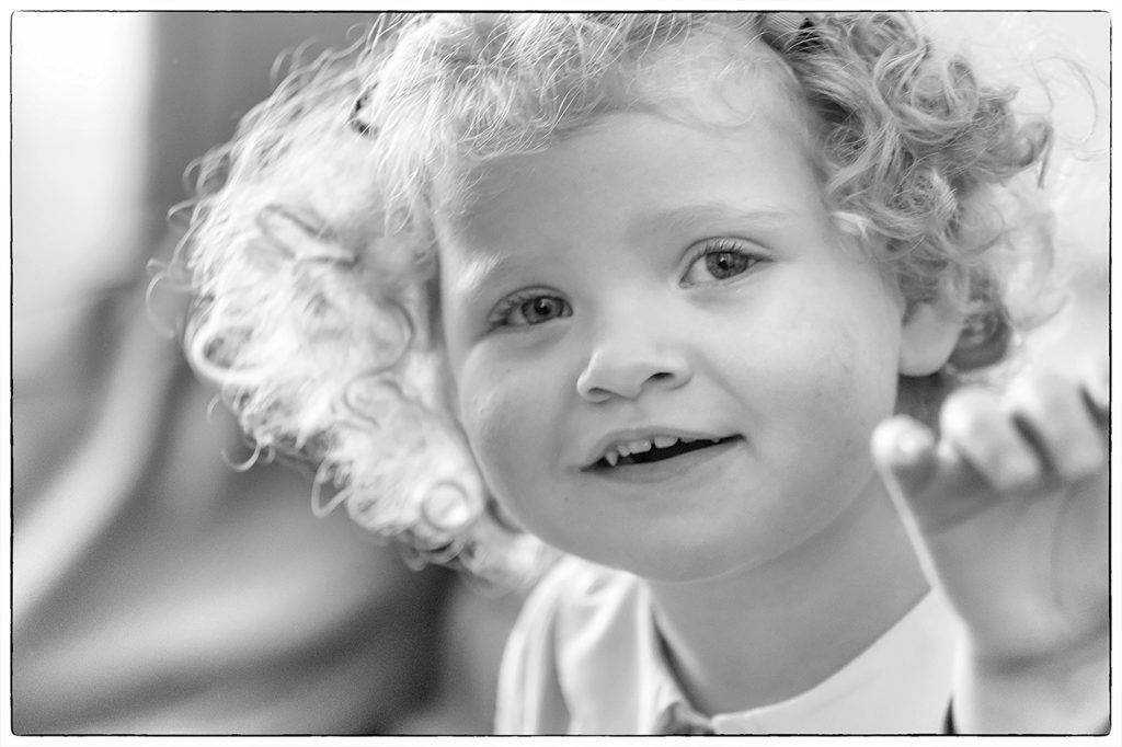 Black and white portrait of a curly-haired girl